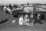 A day out at the races, an alfresco picnic in the car park with and without a chauffeur. The Derby Horse Race Epsom Downs Surrey England 1970.<br />