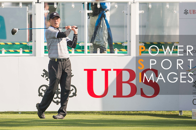 Zhang Lianwei of China tees off the first hole during the 58th UBS Hong Kong Open as part of the European Tour on 08 December 2016, at the Hong Kong Golf Club, Fanling, Hong Kong, China. Photo by Marcio Rodrigo Machado / Power Sport Images