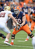 Syracuse Orange tackle Sean Hickey (60) blocks during a game against the Boston College Eagles at the Carrier Dome on November 30, 2013 in Syracuse, New York.  Syracuse defeated Boston College 34-31.  (Copyright Mike Janes Photography)