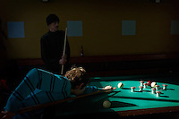 Residents are seen playing pool inside a bar in the city of Lessines, Belgium on March 6, 2013.