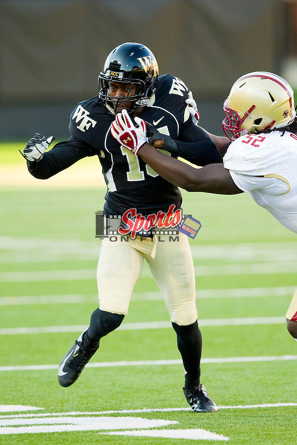 Allen Ramsey II (15) of the Wake Forest Demon Deacons gets blocked by Steven Daniels (52) of the Boston College Eagles on punt coverage at BB&T Field on November 3, 2012 in Winston-Salem, North Carolina.  The Demon Deacons defeated the Eagles 28-14.  (Brian Westerholt/Sports On Film)