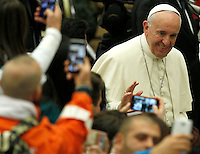 Pope Francis waves faithful as he arrives to lead an audience with young volunteers from Italy's National Civil Service in Paul the VI hall at the Vatican, on November 26, 2016.<br /> UPDATE IMAGES PRESS/Isabella Bonotto<br /> <br /> STRICTLY ONLY FOR EDITORIAL USE