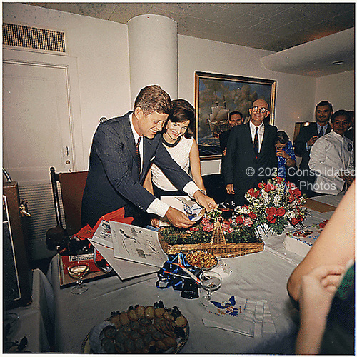 Washington, DC -- President's Birthday Party, given by White House Staff on May 29, 1963 in the White House Navy Mess Hall.  Left to right: U.S. President John F. Kennedy,  First Lady Jacqueline Kennedy, Dave Powers, Kenneth O'Donnell, others. White House, Navy Mess Hall.<br /> Mandatory Credit: Robert Knudsen/White House via CNP