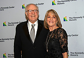 CBS News correspondent Rita Braver, right, and husband Robert Barnett , left, arrive for the formal Artist's Dinner honoring the recipients of the 42nd Annual Kennedy Center Honors at the United States Department of State in Washington, D.C. on Saturday, December 7, 2019. The 2019 honorees are: Earth, Wind & Fire, Sally Field, Linda Ronstadt, Sesame Street, and Michael Tilson Thomas.<br /> Credit: Ron Sachs / Pool via CNP