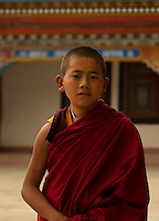 A moment in the day of a Buddhist monk at a monastery in the Himalayan foothills of Sikkim, India