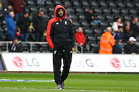 Liverpool manager Jurgen Klopp wraps up warm on a miserable day as he watches the warm up during the Barclays Premier League match between Swansea City and Liverpool played at the Liberty Stadium, Swansea on 1st May 2016