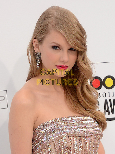 TAYLOR SWIFT.2011 Billboard Awards arrivals at the MGM Grand Garden Arena, Las Vegas, Nevada, USA..May 22nd, 2011.headshot portrait pink lipstick earrings make-up beauty pink strapless beads beaded .CAP/ADM/TW.©Tonya Wise/AdMedia/Capital Pictures.
