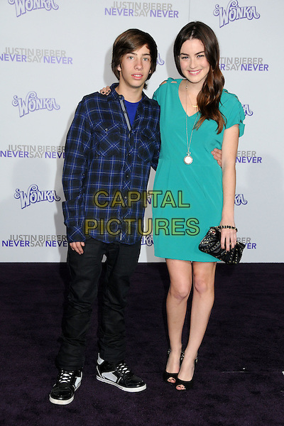 "JIMMY BENNETT & JONNA WALSH.""Justin Bieber: Never Say Never"" Los Angeles Premiere held at Nokia Theater L.A. Live, Los Angeles, California, USA..February 8th, 2011.full length black jeans denim green dress blue check shirt.CAP/ADM/BP.©Byron Purvis/AdMedia/Capital Pictures."