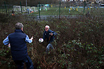 The groundsman retires a match balls from outside the ground during the first-half as Cambrian and Clydach Vale take on Cwmbran Celtic at King George's New Field in a Welsh League Division One match, the top division of the Welsh Football League and the second level of the Welsh football league system. The club, formed in 1965 reached the final of the 2018-19 League Cup final and can count on ex-England manager Terry Venables as a former club chairman. Cambrian and Clydach Vale won this match 2-0, watch by a crowd of around 100 spectators.