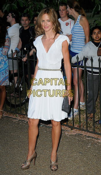 TRINNY WOODALL .At the Serpentine Gallery Summer Party, Serpentine Gallery, Hyde Park, London, England, UK, July 8th 2010..full length white dress waist belt open toe shoes clutch bag pleated .CAP/CAN.©Can Nguyen/Capital Pictures.