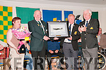 FCA/PDF/RDF Reunion : Jim Halpin & Michael Guerin, organisers of the FCA/PDF/RDF 15th & 32nd Batalions  reunion making a presentation to John O'Mahony & his wife Mary at the Listowel Arms Hotel on Saturday night last.