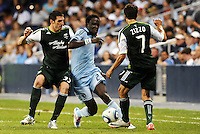 Kei Kamara (23) midfielder Sporting KC inbetween Kenny Coper and Sal Zizzo Portland Timbers... Sporting Kansas City defeated Portland Timbers 3-1 at LIVESTRONG Sporting Park, Kansas City, Kansas.
