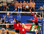 BROOKINGS, SD - SEPTEMBER 25:  Ashley Beaner #11 and Nazya Thies #6 from South Dakota State University try to block the ball of Kelly Law #1 from the University of South Dakota during their match Sunday afternoon at Frost Arena. (Photo by Dave Eggen/Inertia)