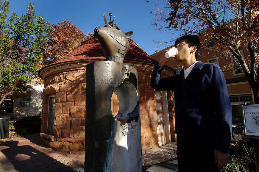 """Tomuaki Toriya, visiting from Japan, samples water from the Cheyenne Spring. """"These are very soda flavored. We don't have these in Japan,"""" he says. Michael Brands for The New York Times."""