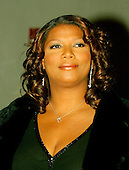 Queen Latifah poses for a photo as she arrives for the eighth annual Mark Twain Prize for American Humor, which is being awarded this year to Steve Martin at the John F. Kennedy Center for the Performing Arts in Washington on October 23, 2005..Credit: Ron Sachs / CNP