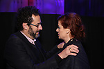 """Tony Kushner and Debra Messing attends The American Associates of the National Theatre's Gala celebrating Tony Kushner's """"Angels in America"""" on March 11, 2018 at the Ziegfeld Ballroom,  in New York City."""