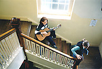 Sarah Waters from Galway practicing guitar on the stairway at Maoin Cheoil and Chláir during the Fleadh Nua - date unknown (1998-2000). Photograph by John Kelly