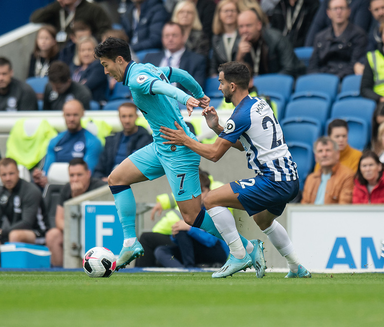 Brighton & Hove Albion's Martin Montoya (right) battles for possession with  Tottenham Hotspur's Son Heung-Min (left) <br /> <br /> Photographer David Horton/CameraSport<br /> <br /> The Premier League - Brighton and Hove Albion v Tottenham Hotspur - Saturday 5th October 2019 - The Amex Stadium - Brighton<br /> <br /> World Copyright © 2019 CameraSport. All rights reserved. 43 Linden Ave. Countesthorpe. Leicester. England. LE8 5PG - Tel: +44 (0) 116 277 4147 - admin@camerasport.com - www.camerasport.com