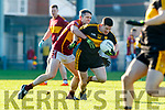 Kieran O'Leary Dr Crokes in action against Gordon Kelly St Joseph's Miltown Malbay during the AIB Munster GAA Football Senior Club Championship Final match between Dr. Crokes and St. Josephs Miltown Malbay at the Gaelic Grounds in Limerick on Sunday.