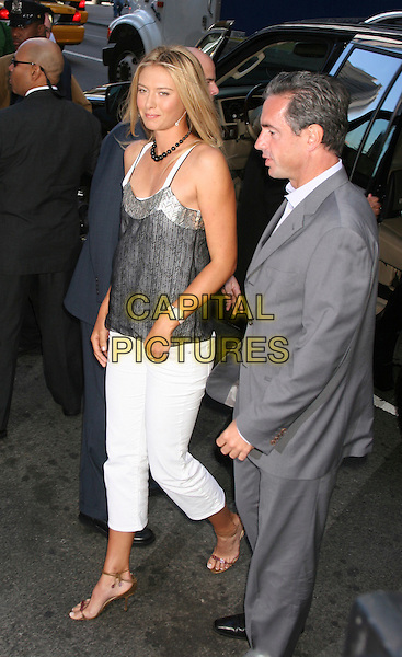 MARIA SHARAPOVA.Launches her new Tag Heuer Watch,.Fortunoff's, Nwy York City, 23rd August 2005.full length tennis player number 1 ranked endorsement product white trousers grey gray strappy top sandals arriving.www.capitalpictures.com.sales@capitalpictures.com.©Capital Pictures
