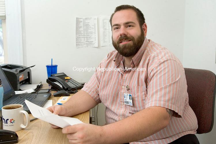 TORRINGTON CT. 12 June 2015-061215SV03-Garrett Deutermann, case manager for opiate addicts, works in his office at Charlotte Hungerford Hospital in Torrington Friday.<br /> Steven Valenti Republican-American