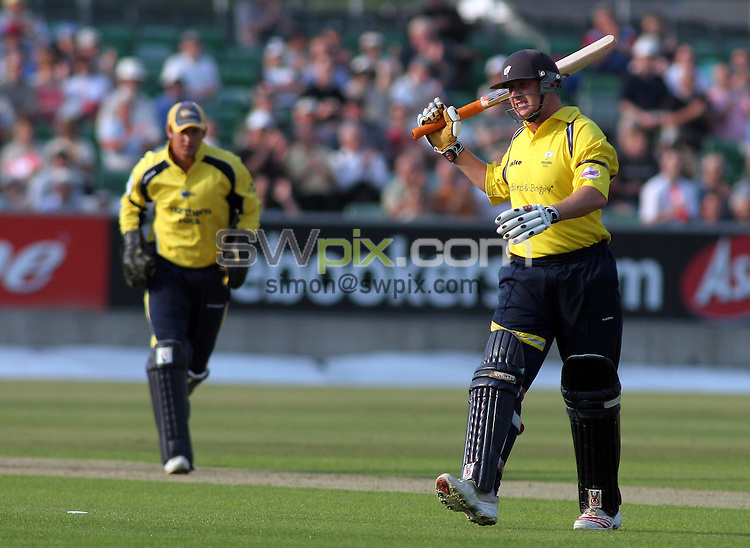 PICTURE BY VAUGHN RIDLEY/SWPIX.COM -  Cricket - Twenty20 Cup - Durham v Yorkshire - Riverside, Chester-le-Street, England - 03/07/06...? Simon Wilkinson - 07811 267706...Yorkshire's Anthony McGrath swings his bat in disgust as he is caught out by Ottis Gibson for 28. (Phil Mustard in pic.)
