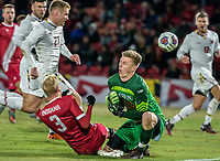 COLLEGE PARK, MD - NOVEMBER 15: Niklas Neumann #36 of Maryland comes out for the ball with Simon Waever #3 of Indiana during a game between Indiana University and University of Maryland at Ludwig Field on November 15, 2019 in College Park, Maryland.
