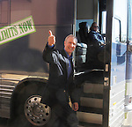 Illinois gubernatorial candidate Bruce Rauner stopped at the Regency Conference Center in O'Fallon as part of a bus trip around the state on Wednesday. Here he gives a thumbs up to well-wishers seeing him off as he returns to the bus, and a trip home to the Chicagoland area.