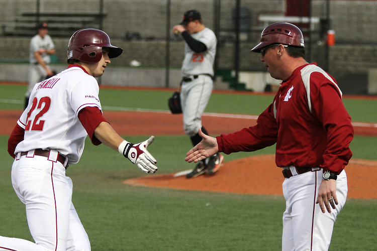 Washington State outfielder, Matt Fanelli (#22), gets a congratulatory shake from head coach Donnie Marbut after hitting a home run during the Cougars Pac-10 conference baseball game against Oregon State at Bailey-Brayton Field in Pullman, Washington, on April 24, 2010.