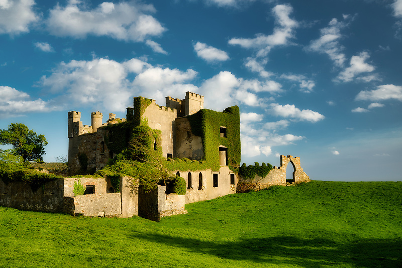 Clifden Castle with clouds and pasture. County Galway, Ireland