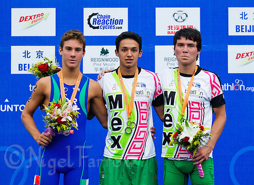07 SEP 2011 - BEIJING, CHN - David Nuñez (MEX) (centre) celebrates winning the junior men's 2011 ITU World Aquathlon Championships with silver medalist Delian Stateff (ITA) (left) and bronze medalist Octavio Oliveros (MEX) .(PHOTO (C) NIGEL FARROW)