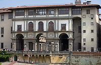 Low angle view of Uffizi Gallery, seen from the River Arno, 1560-81, by Giorgio Vasari, Florence, Tuscany, Italy, pictured on June 10, 2011, in the morning. The internal courtyard opens to the river through a Doric screen. The Uffizi was commissioned by Cosimo I de Medici to house both administrative offices (Uffizi) and the art collection. Florence, capital of Tuscany, is world famous for its Renaissance art and architecture. Its historical centre was declared a UNESCO World Heritage Site in 1982. Picture by Manuel Cohen.
