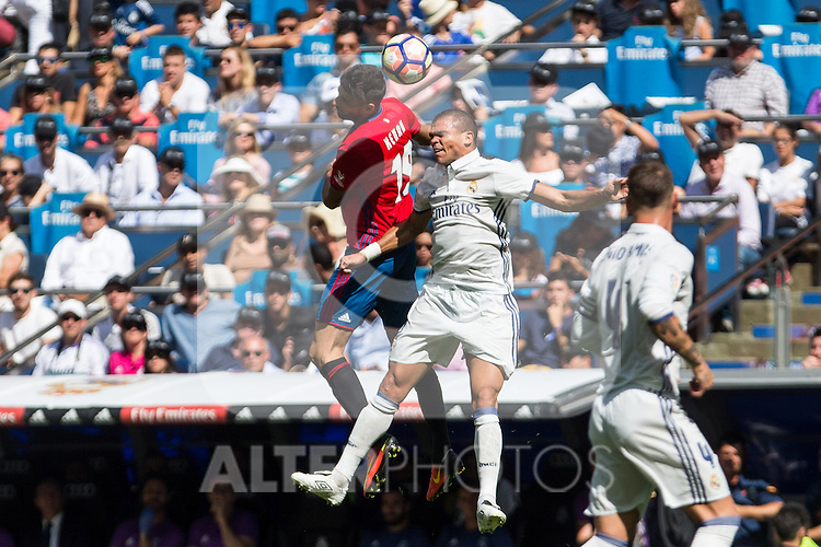 Club Atletico Osasuna's Emmanuel Riviere and Real Madrid's Pepe during the match of La Liga between Real Madrid and Club Atletico Osasuna at Santiago Bernabeu Estadium in Madrid. September 10, 2016. (ALTERPHOTOS/Rodrigo Jimenez)