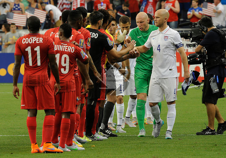 USA players greet the Panama team before the game began. At front right are USA Michael Bradley (4) and USA Brad Guzan (1). Panama tied the USA 1-1 in a Group A game during the Gold Cup 2015 at Sporting Park in Kansas City, Kansas on Monday July 13, 2015.