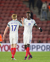 Tammy Abraham (Bristol City (on loan from Chelsea) of England celebrates with Duncan Watmore (Sunderland) of England at full time during the Under 21 International Friendly match between England and Italy at St Mary's Stadium, Southampton, England on 10 November 2016. Photo by Andy Rowland.