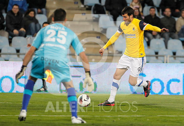 Getafe's Miguel Angel Moya (l) and Real Sociedad's Imanol Agirretxe during La Liga match.March 17,2012. (ALTERPHOTOS/Acero)