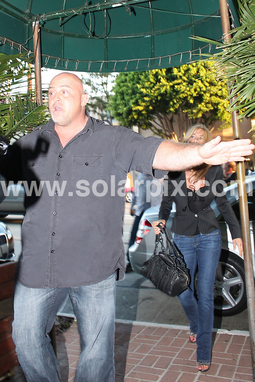 **ALL ROUND PICTURES FROM SOLARPIX.COM**.**WORLDWIDE SYNDICATION RIGHTS**.**NO PUBLICATION IN AUSTRALIA, DENMARK, GERMANY, NEW ZEALAND, RUSSIA, UK OR USA**.Jennifer Aniston arrives at Madeo Restaurant with overzealous body guard in full force, West Hollywood, California, USA. 26th August 2008..This pic: Jennifer Aniston..JOB REF: 7132 LAP (CW)      DATE: 26_08_2008.**MUST CREDIT SOLARPIX.COM OR DOUBLE FEE WILL BE CHARGED* *UNDER NO CIRCUMSTANCES IS THIS IMAGE TO BE REPRODUCED FOR ANY ONLINE EDITION WITHOUT PRIOR PERMISSION*