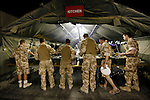 Mcc0018106 . SundayTelegraph..Soldiers queueing for dinner at FOB Shawqat in the Nad e'Ali district of Helmand Province...Afghanistan 7 November 09