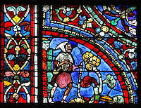 The younger son, dressed in simple shepherd's clothing, walks home to his father. The walk is symbolic of renewal, from the Parable of the Prodigal Son stained glass window, in the north transept of Chartres Cathedral, Eure-et-Loir, France. This window follows the parable as told by St Luke in his gospel. It is thought to have been donated by courtesans, who feature in 11 of the 30 sections. Chartres cathedral was built 1194-1250 and is a fine example of Gothic architecture. Most of its windows date from 1205-40 although a few earlier 12th century examples are also intact. It was declared a UNESCO World Heritage Site in 1979. Picture by Manuel Cohen