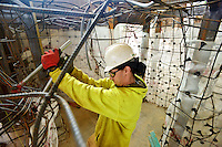 STAFF PHOTO BEN GOFF  @NWABenGoff -- 12/12/14 Raimen Munoz with Big Bamboo Studios, based in Nebraska, fabricates the framework of a limestone cave exhibit inside the main gallery space of the Amazeum under construction in Bentonville on Friday Dec. 12, 2014.