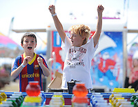 NWA Media/ANDY SHUPE - Friends Xavier Lozen, 9, left, and Hays Brooks, 10, both of Fayetteville celebrate after winning goldfish while playing a midway game Saturday, Aug. 30, 2014, at the Washington County Fair in Fayetteville. The fair concluded Saturday.