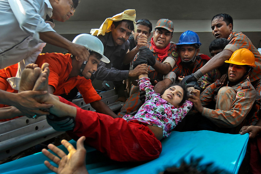 Rescuers lower down a survivor from the debris of a building that collapsed in Savar, near Dhaka, Bangladesh, Wednesday, April 24, 2013.