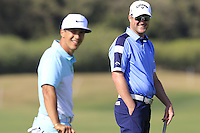 Thorbjorn Olesen (DEN) and Marc Warren (SCO) on the 9th green during Thursday's Round 1 of the 2016 Portugal Masters held at the Oceanico Victoria Golf Course, Vilamoura, Algarve, Portugal. 19th October 2016.<br /> Picture: Eoin Clarke   Golffile<br /> <br /> <br /> All photos usage must carry mandatory copyright credit (© Golffile   Eoin Clarke)