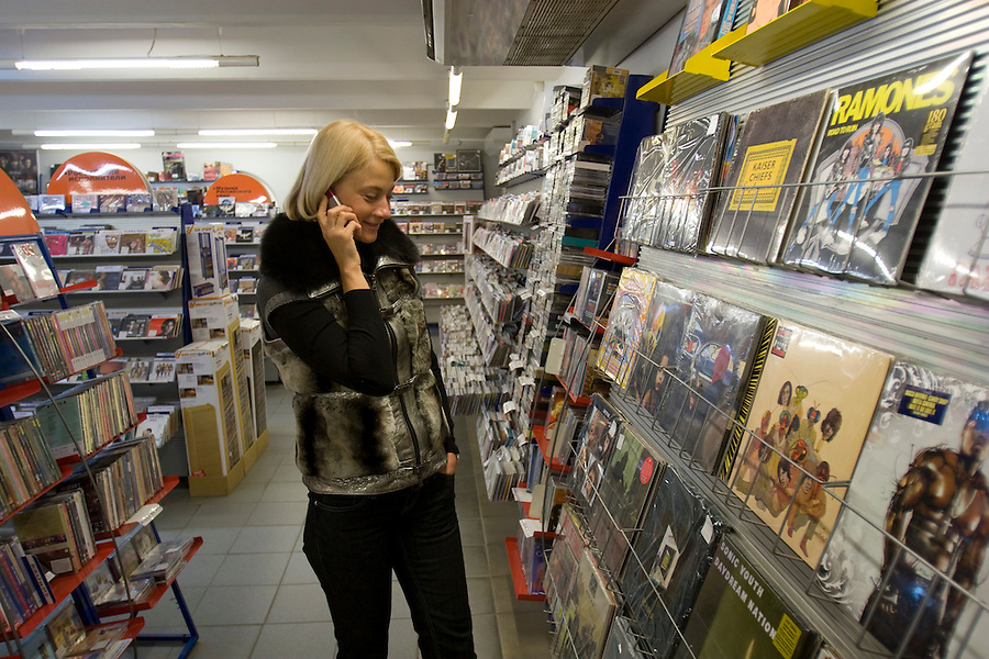 Moscow, Russia, 30/11/2007..Anna Pankratova shopping in the music department of the GUM department store on Red Square.