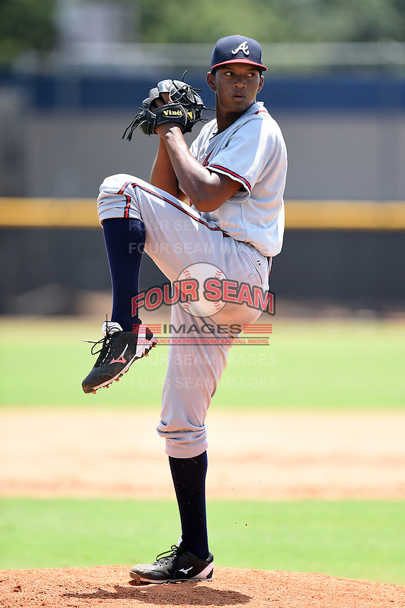 GCL Braves pitcher Clayvon Sambola (63) delivers a pitch during the first game of a doubleheader against the GCL Yankees 1 on July 1, 2014 at the Yankees Minor League Complex in Tampa, Florida.  GCL Yankees 1 defeated the GCL Braves 7-1.  (Mike Janes/Four Seam Images)
