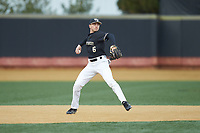 Wake Forest Demon Deacons shortstop Michael Turconi (6) makes a throw to first base against the Illinois Fighting Illini at David F. Couch Ballpark on February 16, 2019 in  Winston-Salem, North Carolina.  The Fighting Illini defeated the Demon Deacons 5-2. (Brian Westerholt/Four Seam Images)