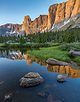 Wind River Range, WY: The Monolith and surrounding cliff faces with sunrise light reflecting in the Popo Agie River; Popo Agie Wilderness; Shoshone National Forest