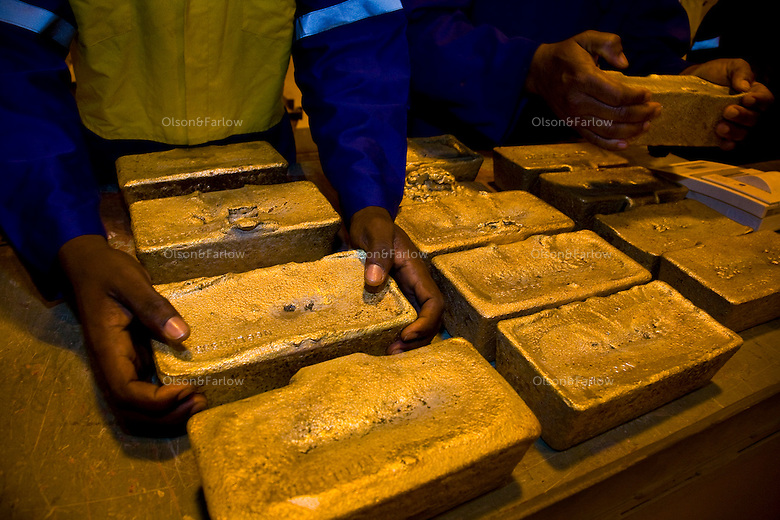 Newmont Ghana is a two year old gold mine that pulls about 500,000 onces a year out of this gold mine.  The helicopter came in for the gold today so it had to be packed and sorted.  They shipped out 14 bars with an average weight of 22KG each and worth about 7 million USD.