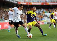 Valencia, Spain. Thursday 19 September 2013<br /> Pictured: (L-R) Andres Guardado, Jonathan de Guzman.<br /> Re: UEFA Europa League game against Valencia C.F v Swansea City FC, at the Estadio Mestalla, Spain,