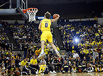 "Michigan guard Zack Novak competes in a slam dunk contest against teammates during the college basketball team's ""Michigan Madness"" festivities at Crisler Arena, Friday, Oct. 16, 2009, in Ann Arbor, Mich. (AP Photo/Tony Ding)"
